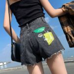 Abstract Art Face Ripped Denim Shorts